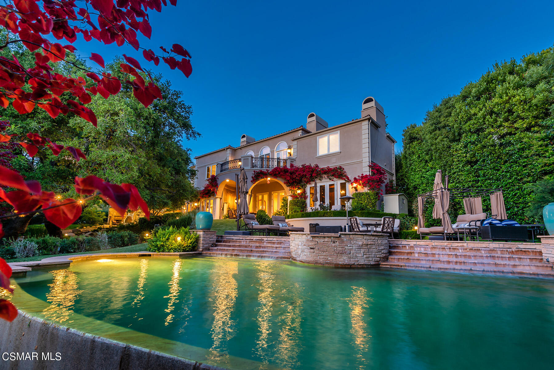Absolutely stunning custom Mediterranean with a premier end of cul-de-sac location in the prestigious gated community, Emerald Forest  of North Ranch! A magical setting boasting mature oaks, complete privacy and  sensational views of the golf course. Interior features include a grand two story entrance with floating staircase. Other features include a second story bonus/billiards room, separate paneled office/library, 5 bedrooms with four up and one down, 5.5 baths and much more. The master suite boasts a huge viewing balcony, fireplace and also provides two walk in closets. The recently remodeled center island kitchen has all new top of the line appliances, custom  cabinetry and quartzite counters. The rear grounds are simply spectacular with an infinity pebble tech pool and spa, basketball/sports court, custom fountains, outdoor fireplace, covered patios, cascading pond, barbecue center and tremendous pathways through a breathtaking oak tree forest. A truly remarkable setting! Other amenities include a second story laundry room, surround sound and security cameras, remodeled gym, newer LED lighting, finished over sized three car garage and much more.