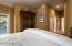 Downstairs bedroom with view to en suite bathroom