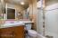 Downstairs bedroom en suite bathroom with convenient step-in shouwer