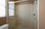 Shower over tub in shared bathroom