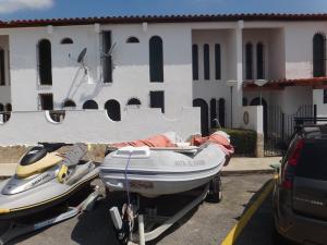 Townhouse En Ventaen Higuerote, Puerto Encantado, Venezuela, VE RAH: 18-4339