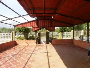 Terreno En Ventaen Santa Rita, El Mene, Venezuela, VE RAH: 18-7057