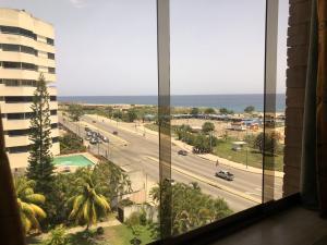 Apartamento En Ventaen Parroquia Caraballeda, Palmar Este, Venezuela, VE RAH: 18-11626