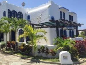 Townhouse En Ventaen Higuerote, Puerto Encantado, Venezuela, VE RAH: 19-11100