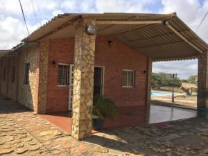 Casa En Ventaen Pueblo Nuevo, Pueblo Nuevo, Venezuela, VE RAH: 20-4851
