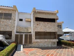 Townhouse En Ventaen Higuerote, Puerto Encantado, Venezuela, VE RAH: 20-21687