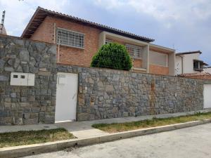 Casa En Ventaen Caracas, Macaracuay, Venezuela, VE RAH: 21-2748