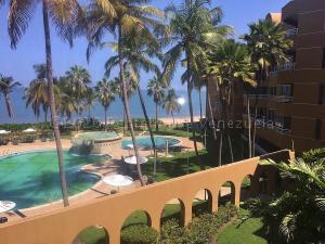 Apartamento En Ventaen Lecheria, Complejo Turistico El Morro, Venezuela, VE RAH: 21-8980
