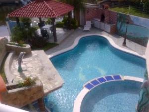 Casa En Ventaen Higuerote, Puerto Encantado, Venezuela, VE RAH: 21-10243