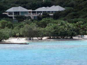 Beautiful sugar sand beach is just steps from this pristine tropical Villa