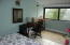 Bedroom 2 with enclosed balcony for office area