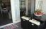 Porch opens to great room with door and glass sliding door