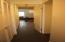 Hallway to bathrooms and bedroom