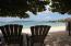 Grab a chair under the sea grape trees