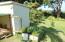 Pump house, chicken coop, herb garden in raised bed