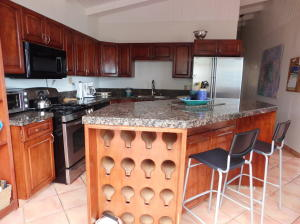 Maple cabinets granite counter tops, large island/breakfast bar with duel wine racks.