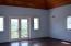 Hardwood flooring and ceilings; Doors open to a juliet balcony overlooking pool