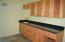 Granite counter and beautiful wood cabinetry