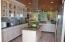 large kitchen adjacent to living room