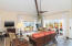 Cathedral ceilings and spacious living room surrounded by glass sliding doors