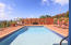 Pool is privately set on property with a fenced entry