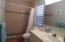 Bathroom with retiled shower area