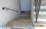 stairs down being re-tiled with slip resistant tiles