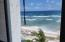 Top-floor unit with sandy beach, brisk trade winds & sweet view of Buck Island.