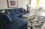 Brand new Ashley wraparound sofa , rug, etc