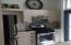 Neat kitchen with stainless steel appliances and lots of storage