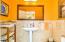Travertine walls and floor in powder room off kitchen