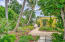 Custom patio walkway through professionally landscaped gardens with drip irrigation
