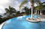 Infinity edge pool with palm island