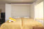 Murphy beds in living room provide sleeping for 2