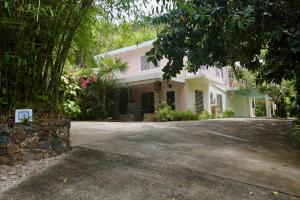 lovely island home with a carport and income producing apartment