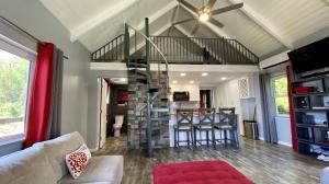 Loft upstairs, bedroom behind kitchen, bathroom to the left.