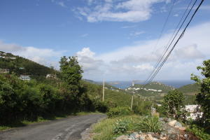 View of the land going down the road. The land is on the left