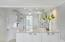 Beautiful white and gray marble countertops, glass front upper cabinets and energy efficient appliances
