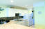 Beautifully remodeled kitchen with stacked washer/dryer