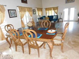 An Expansive room that runs from the side door to the front door with the dining and living rooms in between,