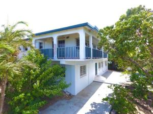 Large fully furnished 1 BR/1BA property with ocean, green cay & East End view & private parking.