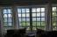 window looking to view in master bedroom
