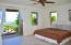 Downstairs bedroom on Eastern side of laundry room with private balcony to enjoy the ocean view & view of caribbean islands.