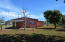 Concrete home with wooden addition & large yard minutes to the beach