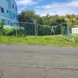Front of fenced vacant lot