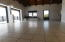 Currently unfurnished, An enormous space for formal living room, casual dining if you like, entertainment center.