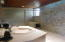 The pool house offers another beautiful bathroom. For guest enjoying the pool or for them to freshen up after a great workout.