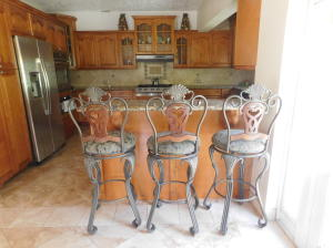 If you choose to come in the side entrance, you are right at the kitchen entrance and this lovely breakfast bar and stools