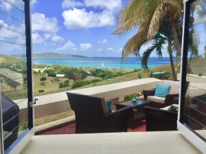Sit down for meals or cocktails overlooking the sea and Buck Island!