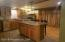 Beautifully Updated-Glass front cabinets, stainless steel appliances, granite countertops, island